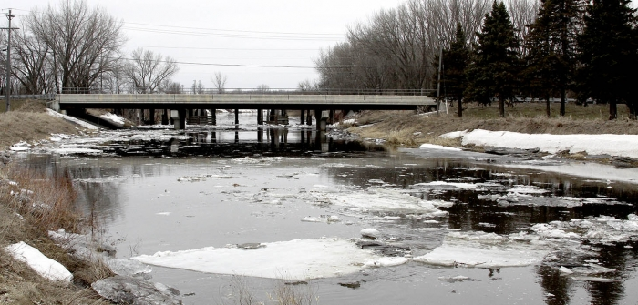 Large ice sheets passed through the Minnesota 9 and BNSF railroad bridge this spring without jamming up and forming a dam.