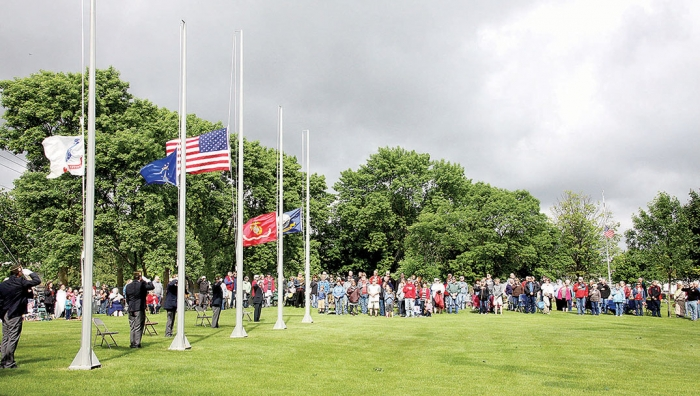 It was a cool, cloudy day as area residents gathered in the Benson City Cemetery to honor America's war heroes.