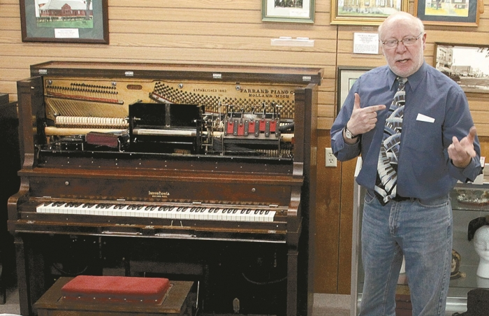Steve Misener explains the insides of a player piano.