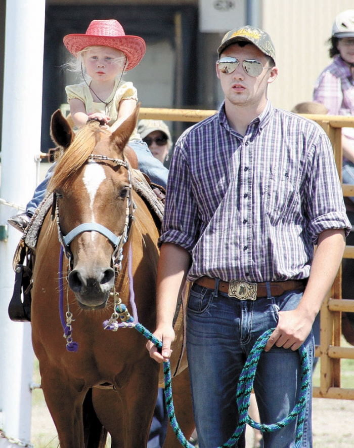 Jake Goff and niece Adisyn wait their turn to participate in Saturday's Shamrock-Hest Riding Club's events.