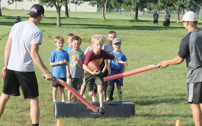 Helping out with a runningback drill in the picture above were volunteer coaches Hunter Gonnerman (left) and Adam Zosel.