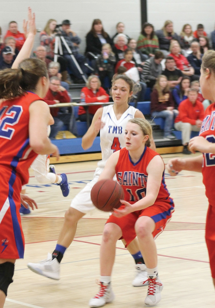 Samantha Gjerde pulls up for a jumper in the lane during the Saints' 51-50 loss to Tracy Area last Tuesday night in Murdock.