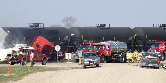 U.S. 12 between DeGraff and Murdock remained closed Wednesday morning following the collission of a tanker truck hauling anhydrous ammonia and a BNSF train.