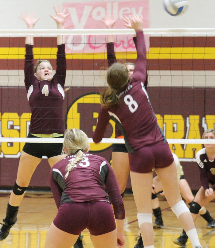 Hanna Lindblad puts up a set for Victoria Pagel or Anna Gosson (back) during a loss to Sauk Centre