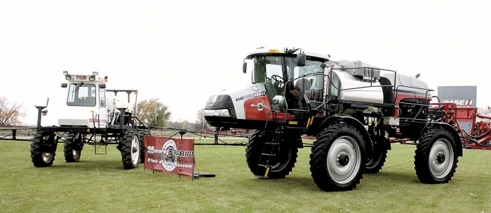 An oringal Patriot sprayer sits next to the modern version in front of the CNHI plant on west U.S. Highway 12 in Benson.