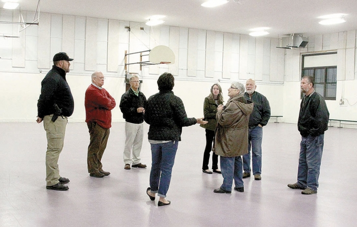 Benson's City Council and Chief of Police Ian Hodge (at left) toured the Armory building last Tuesday night trying to get an idea of how it would work for a new police deparment, city hall, or both.   From left are Hodge, City Manager Rob Woflington, Director of Finance Glen Pederson, Council Members Terri Collins, Stephanie Heinzig, Sue Fitz, Mayor Gary Landmark and Jack Evenson.