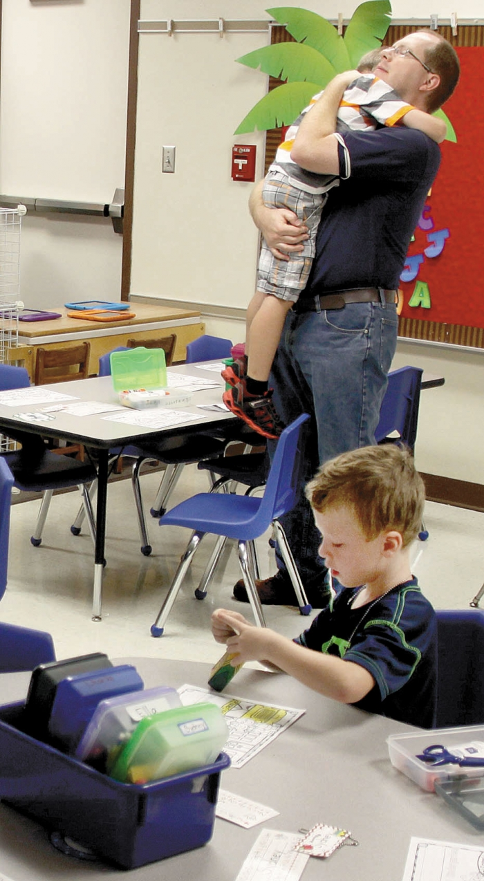 David Hafvenstein gives his son John a final hug on the first day of school at Northside Elementary.
