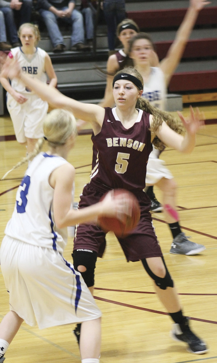 Courtney McNeill (5) plays defense on Bailey Buccholz (3).
