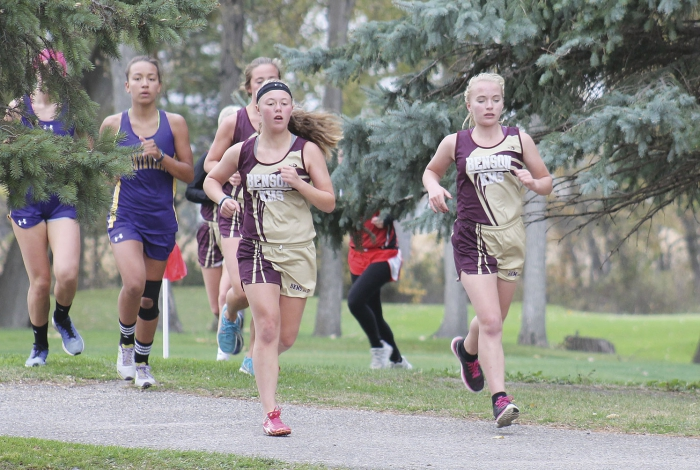 Ashley Tostenson, Kaitlyn Berreau (middle) and Serenity Driscoll (behind Berreau) race for the Benson-KMS girls cross-country team at the Benson Invitational.