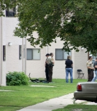 Benson police and Swift County sheriffs deputies outside the Nevada Square Apartments unit where Henderson was arrested.