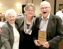 Jerry Johannessen is all smiles after being inducted into the Upper Midwest Bakery Association's Hall of Fame earlier this month. He is pictured with wife, Carol, left, and Benson Bakery employee Becky Halverson. It was Halverson who submitted the Johannessen's nomination letter for the hall of fame. Photo provided.