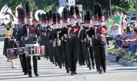 The Benson Marching Band. Three performers in front are: Kyle Reese on snare, Morgan Schmidt and Madisen Wieber playing flute.