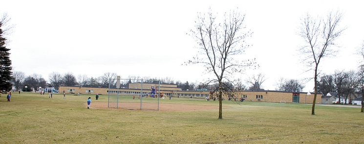 Children play outside on the spacious grounds of the Northside Elementary School Monday at noon. District 777's Board of Education is considering some of the land to add six classrooms that would allow it to expand its early childhood and day care  to children in the area.