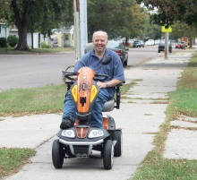 Johnny Johnson's new motorized scooter, courtesy of the Benson Lions and the entire community, has allowed him to get around the town with ease and allows him to venture much farther away from his home than he was accustomed to.  Despite being very independent and wanting to do things for himself, Johnny was very appreciative to everyone for the generous gift.