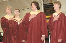 """From left to right Jonas Habben, Taylor Duncan, Devon Liles, and Kyle Reese perform """"Lydia, The Tatooed Lady"""" during the Spring Concert, Monday night in the senior high gym.  The Junior High concert took place at 5 p.m. followed by the 9th-12th grade concert at 7 p.m.  More pictures next week."""