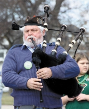 Jack and Denise Lundquist, bagpipers who live near Watertown, S.D., marched in the annual St. Patrick's Day parade in Benson Saturday. Paul Estenson sponsored the bagpipers for the parade.