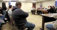 Farmer Ben Vadnais urges the Swift County Board of Commissioners to delay their vote on building a new justice center pointing out that the farm economy isn't good and that the ag sector can only take so much additional cost on the land at this time. Nearly 90 people crowded into the county board room to hear what the board would do Tuesday morning.