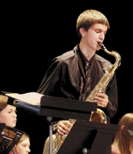 Henry Dammeyer performs a solo on the tenor saxophone during the Jazz n' Stuff concert, Monday night in the Jr. High Auditorium.