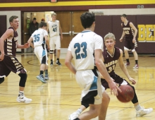 Max Peterson plays defense on an ACGC player as Adam Lindahl (left) gets into position for a trap and Nathan Habben (back, right) watches a few other ACGC players.