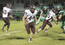 Brett Sulier (44) runs for some hardearned yards against Paynesville.
