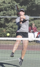 Gracie Grussing returns a shot during doubles' action for the Braves.  Benson was eliminated by Montevideo in the section team tourney, but Grussing is among six players playing in the section individual tourney this week.